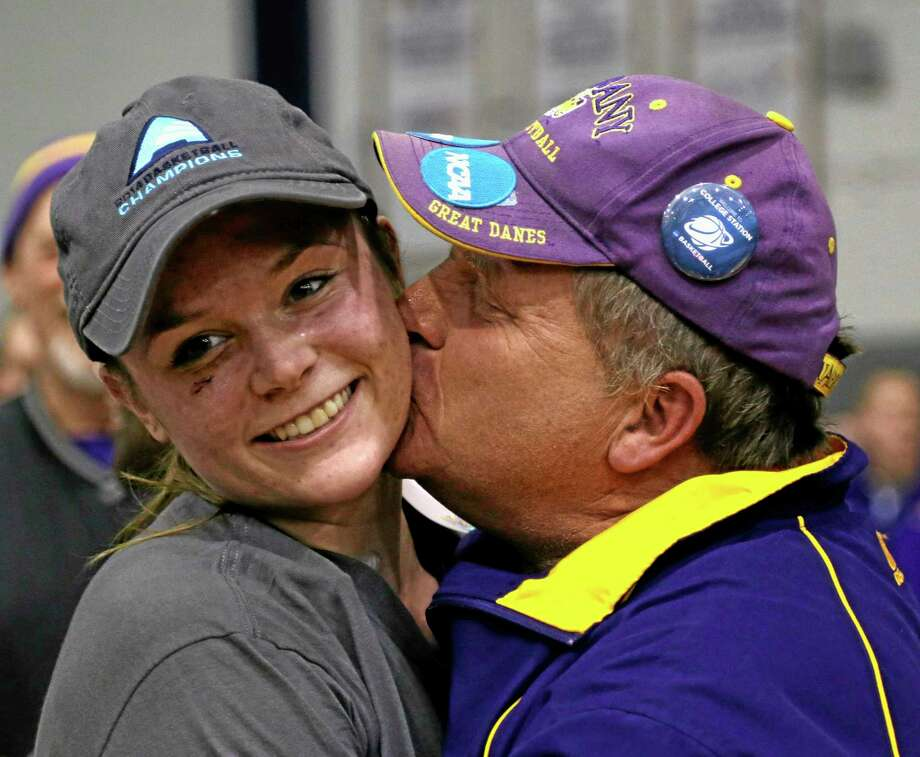 Albany guard Sarah Royals gets a kiss from her father Raymond Royals after Albany's 70-46 win over Stony Brook in an NCAA America East college championship basketball game on Monday. Photo: Mike Groll — The Associated Press  / AP