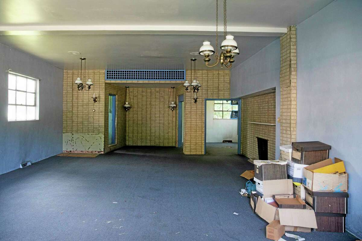 A view of the inside of the former Minus Funeral Home in Dover, Del., Thursday, Aug. 7, 2014, where police say the cremated remains of nine victims of a 1978 mass cult suicide-murder in Jonestown, Guyana, were discovered. The state Division of Forensic Science has taken possession of the remains, discovered at the former Minus Funeral Home in Dover, and is working to make identifications and notify relatives, the agency and Dover police said in a statement. The division last week responded to a request to check the former funeral home after 38 containers of remains were discovered inside. Thirty-three containers were marked and identified. They spanned a period from about 1970 to the 1990s and included the Jonestown remains. (AP Photo/Evan Vucci)