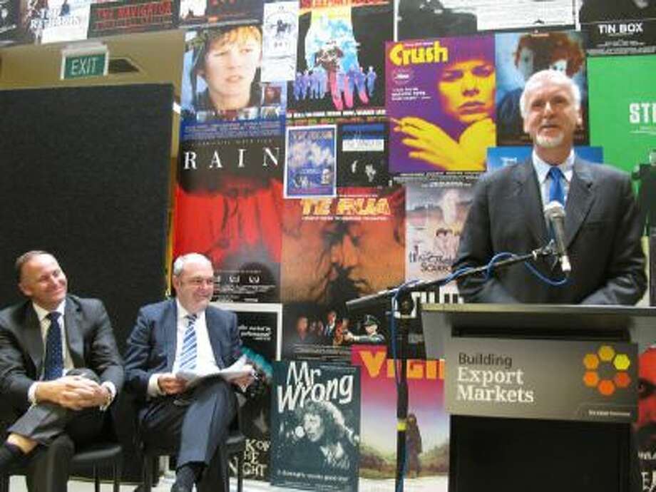 """Director James Cameron (right) announces on Monday, December 16, 2013, in Wellington, New Zealand, that he will shoot three sequels to his blockbuster movie """"Avatar"""" in New Zealand. He is joined by New Zealand Prime Minister John Key (left) and Economic Development Minister Steven Joyce (center). Avatar won three Academy Awards and is the highest-grossing film in history."""
