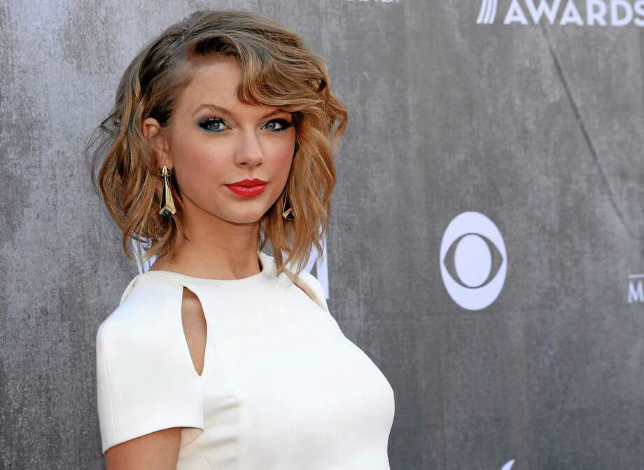 FILE - In this April 6, 2014 file photo, singer Taylor Swift arrives at the 49th annual Academy of Country Music Awards at the MGM Grand Garden Arena in Las Vegas. D(Photo by Al Powers/Powers Imagery/Invision/AP, File) Photo: AP / Invision
