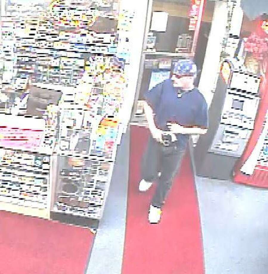 A surveillance camera photo shows a man who police say robbed the Smokers Club on Main Street in Torrington on Aug. 8, 2013.