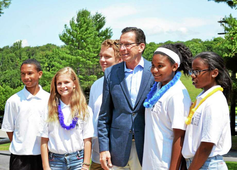 Gov. Dannel Malloy stands with a group of students enrolled in the Connecticut Junior Republic's SAFE program in Litchfield Friday. Photo: Jenny Golfin — The Register Citizen