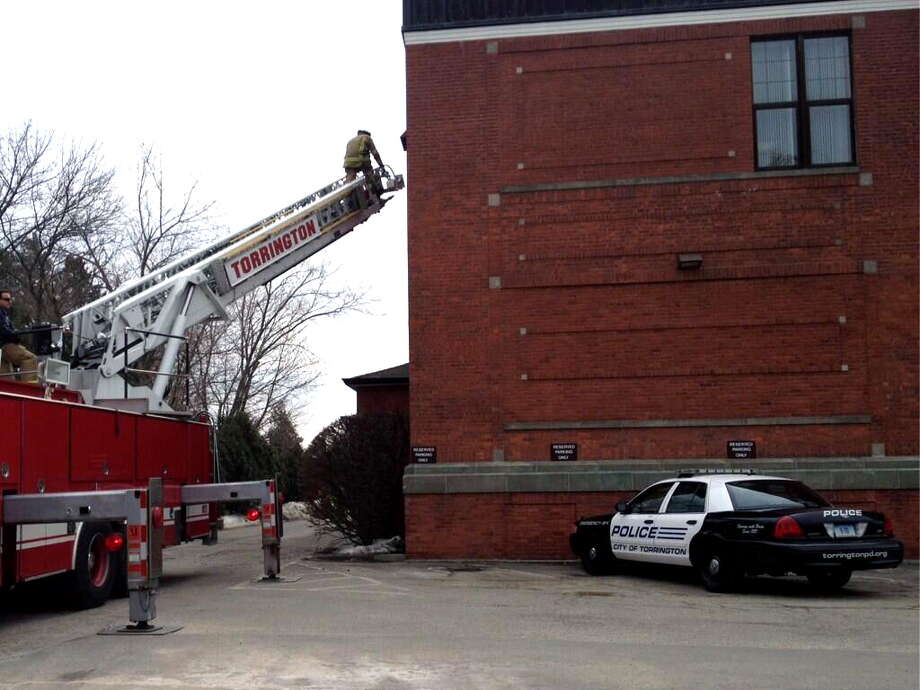 The Torrington Fire Department responded to a fire call at Torrington Police headquarters, located at 576 Main St., Monday afternoon. Photo: Isaac Avilucea — Register Citizen