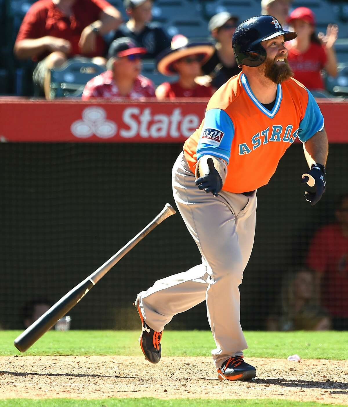ANAHEIM, CA - AUGUST 27: Brian McCann #16 of the Houston Astros smiles as he runs to first after hitting a three RBI triple in the eighth inning of the game against the Los Angeles Angels of Anaheim on August 27, 2017 in Anaheim, California. (Photo by Jayne Kamin-Oncea/Getty Images)
