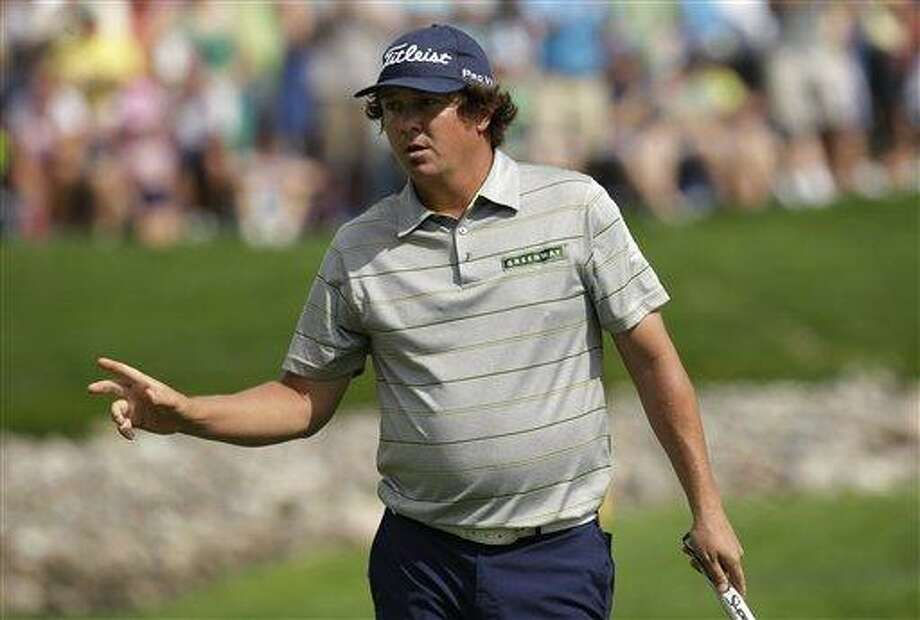 Jason Dufner celebrates after a birdie on the 11th hole during the second round of the PGA Championship golf tournament at Oak Hill Country Club, Friday, Aug. 9, 2013, in Pittsford, N.Y. (AP Photo/Charlie Neibergall) Photo: AP / AP