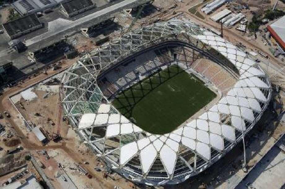 In this Dec. 10, 2013 photo, an aerial view of the Arena da Amazonia stadium in Manaus, Brazil.