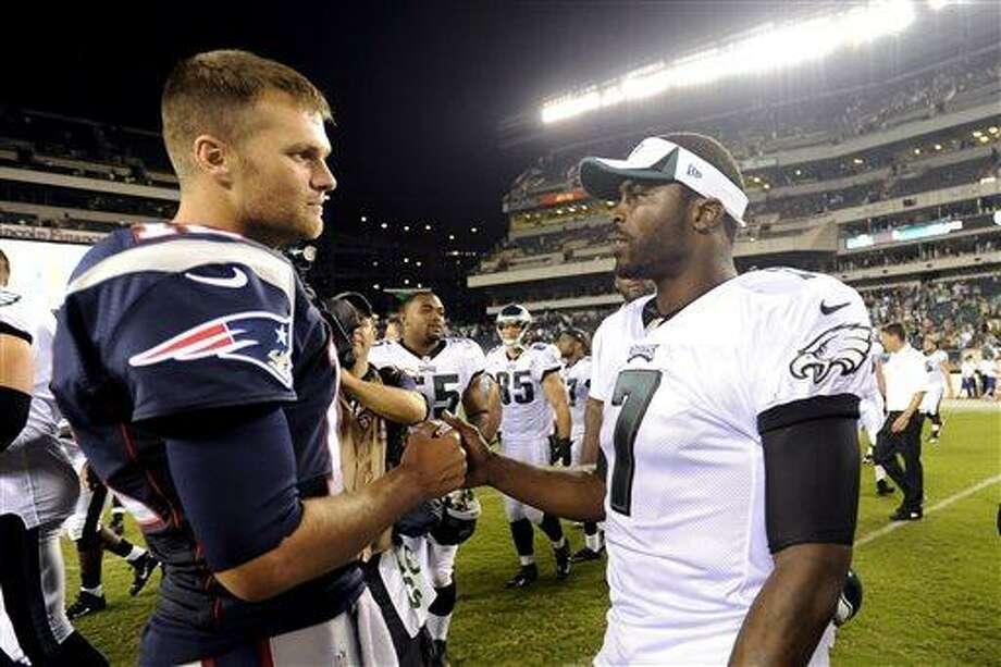 New England Patriots quarterback Tom Brady, left, and Philadelphia Eagles quarterback Michael Vick meet after a preseason NFL football game on Friday, Aug. 9, 2013, in Philadelphia. New England won 31-22. (AP Photo/Michael Perez) Photo: AP / FR168006 AP
