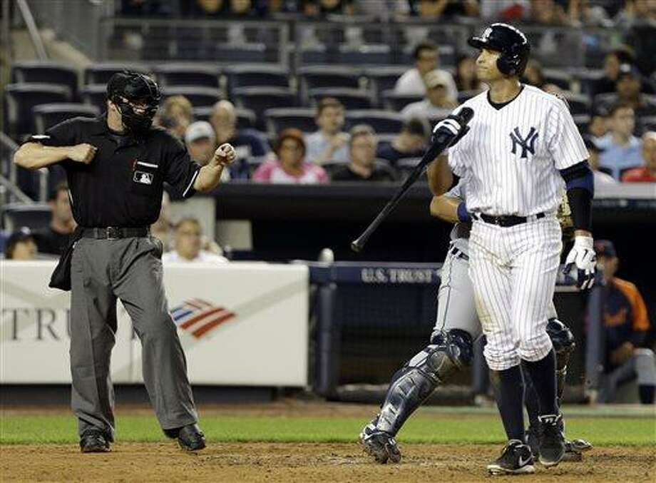 New York Yankees' Alex Rodriguez walks back to the dugout after striking out during the eighth inning of a baseball game against the Detroit Tigers Friday, Aug. 9, 2013, in New York. (AP Photo/Frank Franklin II) Photo: AP / AP
