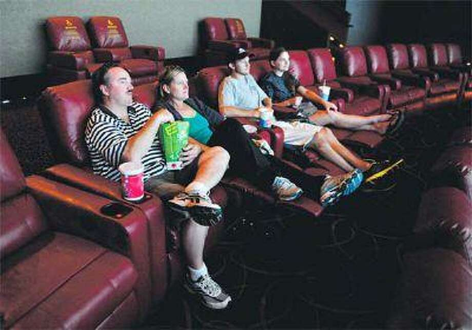 John and Donna Pawlik, joined by their children Chris and Samantha, take in a movie at the newly renovated AMC Flatiron Crossing 14 on Wednesday. The 14-screen venue, which features a full bar, completed its renovation in July and has already seen significant growth in sales, says a company spokesman. (Karl Gehring, The Denver Post)