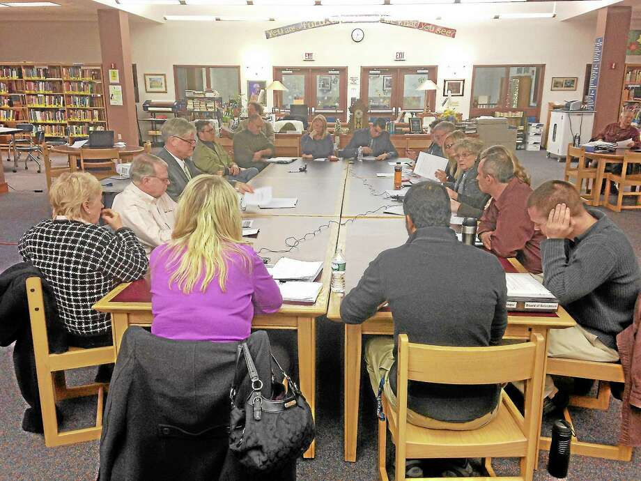 Members of the Winchester Board of Education, The Gilbert School, and the Board of Selectmen convene during a joint meeting Monday, Dec. 16, 2013. Photo: Mercy Quaye—Register Citizen