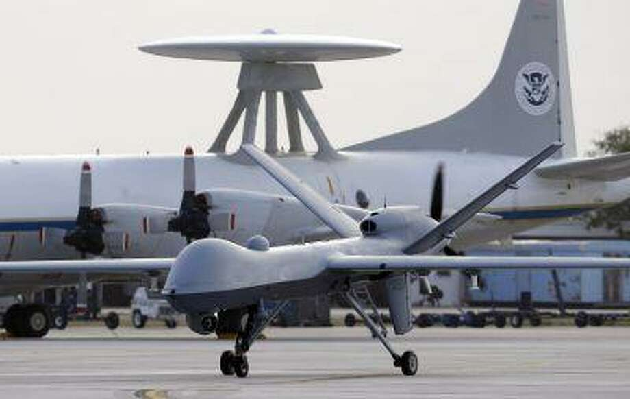 In this Nov. 8, 2011 file photo, a Predator B unmanned aircraft taxis at the Naval Air Station in Corpus Christi, Texas. Photo: AP / AP