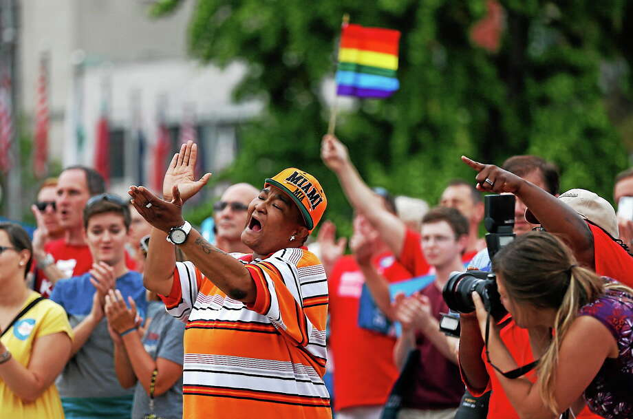 Corey Smith of Mt. Healthy, Ohio joined hundreds of others along with the group Why Marriage Matters Ohio at a rally for gay marriage in Lytle Park on  Aug. 5, 2014 in Cincinnati. Federal appeals courts soon will hear arguments in gay marriage fights from nine states, part of a slew of cases putting pressure on the U.S. Supreme Court to issue a final verdict. Photo: AP Photo/The Cincinnati Enquirer, Jeff Swinger  / The Cincinnati Enquirer