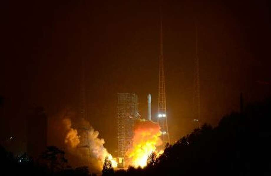 A Long March-3B carrier rocket carrying China's Chang'e-3 lunar probe takes off from the Xichang Satellite Launch Center on December 2, 2013 in Xichang, China. (Photo by ChinaFotoPress/Getty Images)