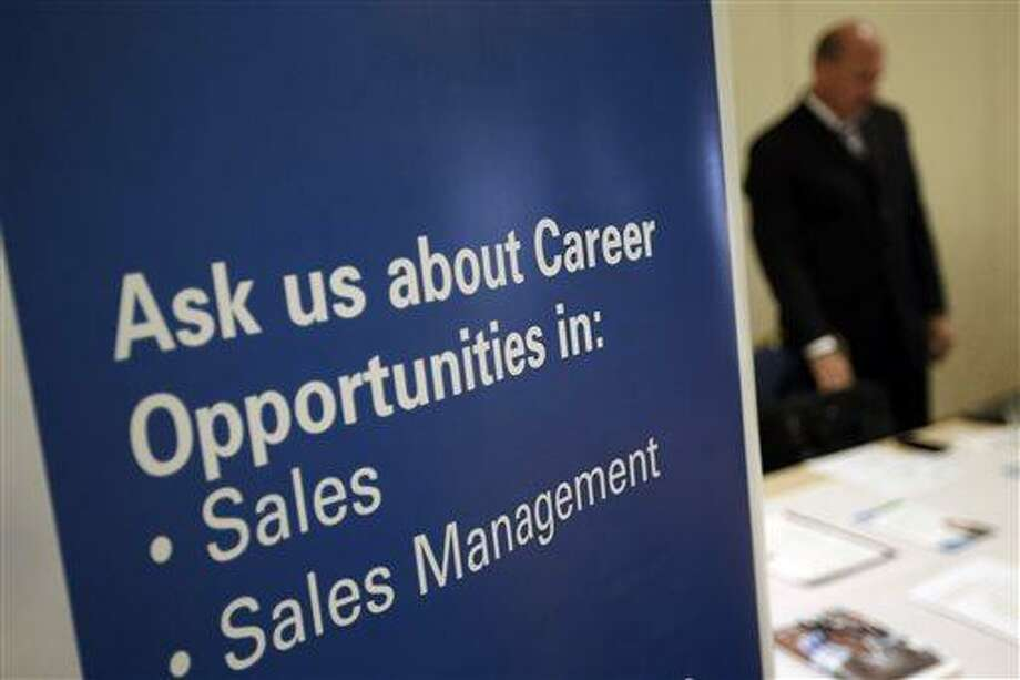 In this  Monday, June 24, 2013, photo, a recruiter waits to meet with job seekers at a career fair, in King of Prussia, Pa. The Labor Department reports on the number of Americans who applied for unemployment benefits in the last week of July on Thursday, Aug. 1, 2013. In the previous week, applications rose to 343,000. Weekly applications can be volatile in July because of summer shutdowns at auto plants that can cause temporary spikes in layoffs. Still, the broader trend has been favorable and consistent with steady job growth.  (AP Photo/Matt Slocum) Photo: AP / AP