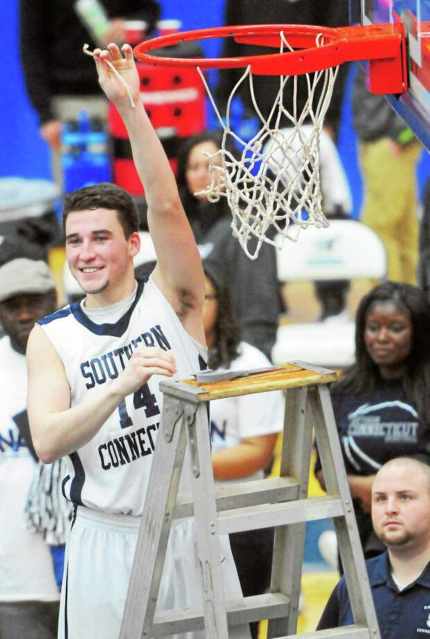 Southern Connecticut State's Luke Houston cuts down his piece of the net during the Owls' celebration after defeating the University of New Haven 73-71 in the Northeast-10 tournament final at Moore Field House on Saturday. Register sports columnist Chip Malafronte points out that Houston and the Owls aren't the only ones having a good winter — the four other New Haven-area colleges all boasted serious contenders this season as well. Photo: Peter Hvizdak — Register  / ©Peter Hvizdak /  New Haven Register