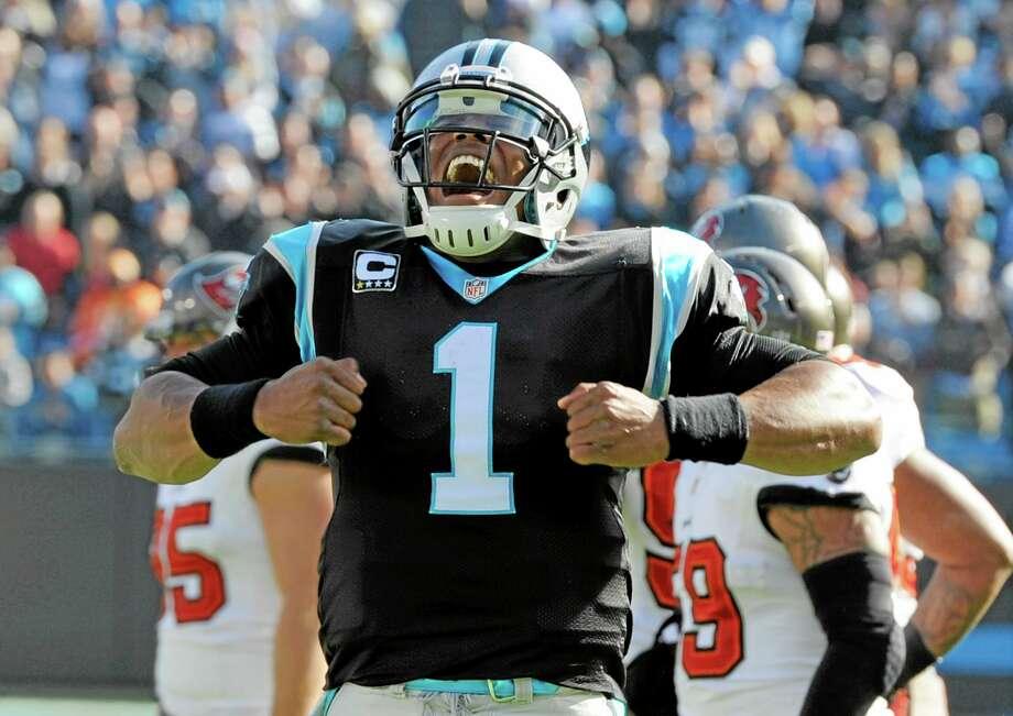 Carolina Panthers quarterback Cam Newton celebrates a touchdown earlier this season. Photo: Mike McCarn — The Associated Press  / FR34342 AP