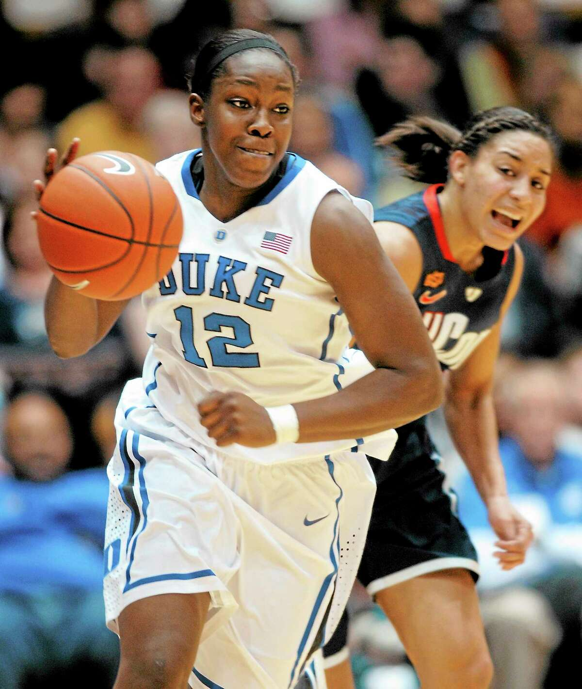 Duke's Chelsea Gray, front, steals the ball from UConn's Bria Hartley during last season's game.