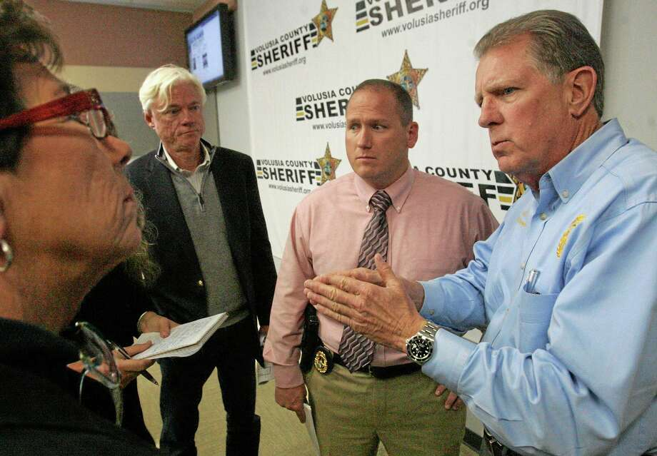 Volusia County Sheriff Ben Johnson , right,  with investigator Sgt. Richard Forton, center, talks with the media on Friday March 7, 2014 in Daytona Beach, Fla.  Ebony Wilkerson, 32, who drove a minivan carrying her three young children into the ocean surf off Florida,  faces attempted murder and other charges Friday, with authorities saying the children were screaming to bystanders that she was trying to kill them.  Wilkerson was placed in custody of the sheriff's office Friday after she had been hospitalized for a mental evaluation since Tuesday. Her children were with the Department of Children and Families. Wilkerson faces three counts each of attempted first-degree murder and aggravated child abuse, Johnson said. (AP Photo/The Daytona Beach News-Journal, David Tucker) Photo: AP / The Daytona Beach News-Journal