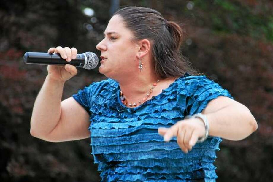 Bobbi Jo Klug, a Torrington resident, sings during a Northwest Idol semi-final performance on July 13 outside Coe Memorial Park Civic Center. Klug is one of 12 finalists performing at the Warner Theatre on Saturday for the title of Northwest Idol 2013, and is one of several finalists from Torrington. Esteban L. Hernandez Register Citizen Photo: Esteban Hernandez, Register Citizen