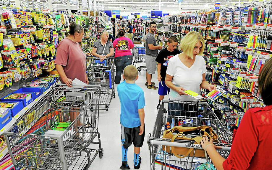 Shoppers take advantage of a state sales tax holiday during the three-day tax holiday event at the Wal-Mart on Aug. 1, 2014, in Alcoa Tenn. Photo: AP Photo/The Knoxville News Sentinel, Michael Patrick  / Knoxville News Sentinel