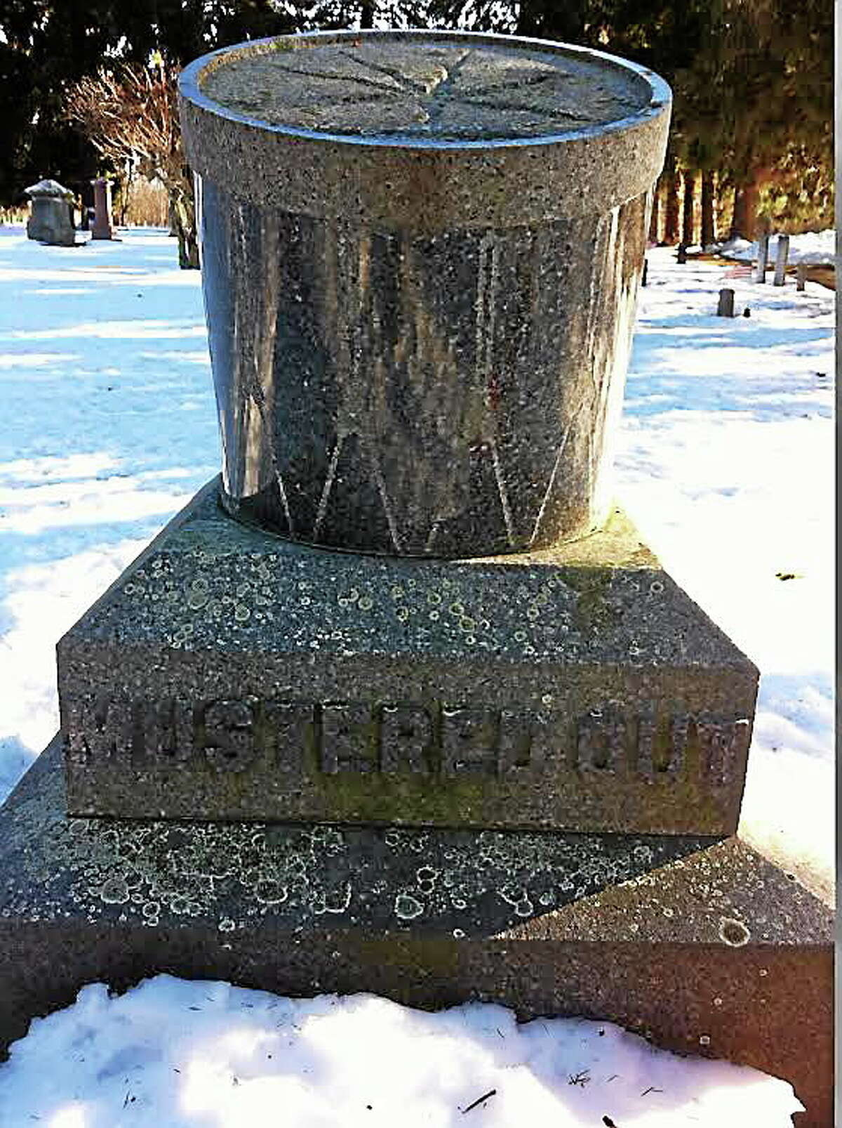 This Civil War monument in Soldiers' Lot, West Cemetery, Litchfield, is a granite drum of the type used in military bands, mounted at an angle on a granite base.