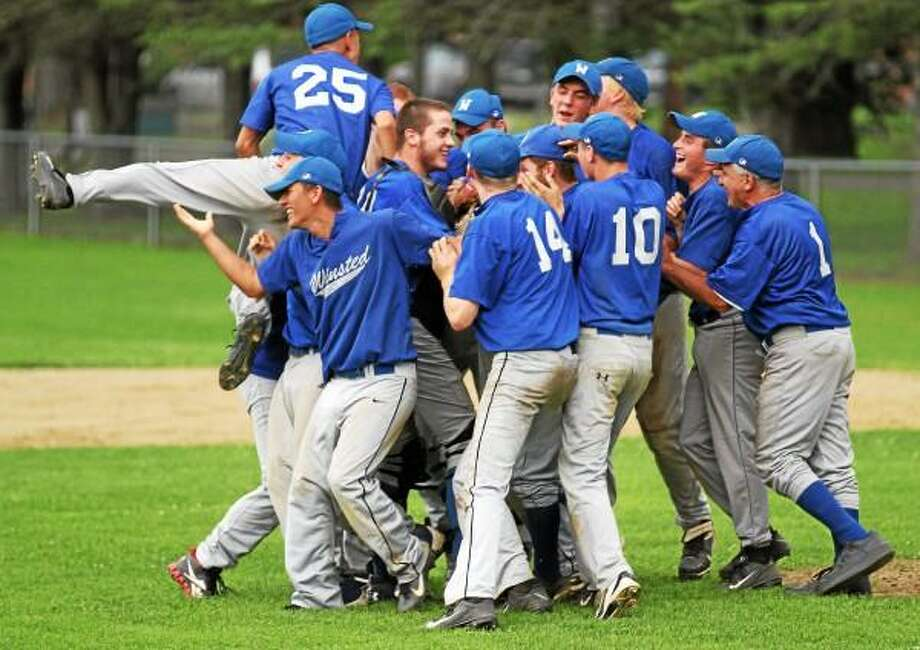 Winsted celebrates after winning the Connie Mack championship title after beating Amenia 7-6 in the third and final game of the championship series. Marianne Killackey/Special to the Register Citizen / 2013