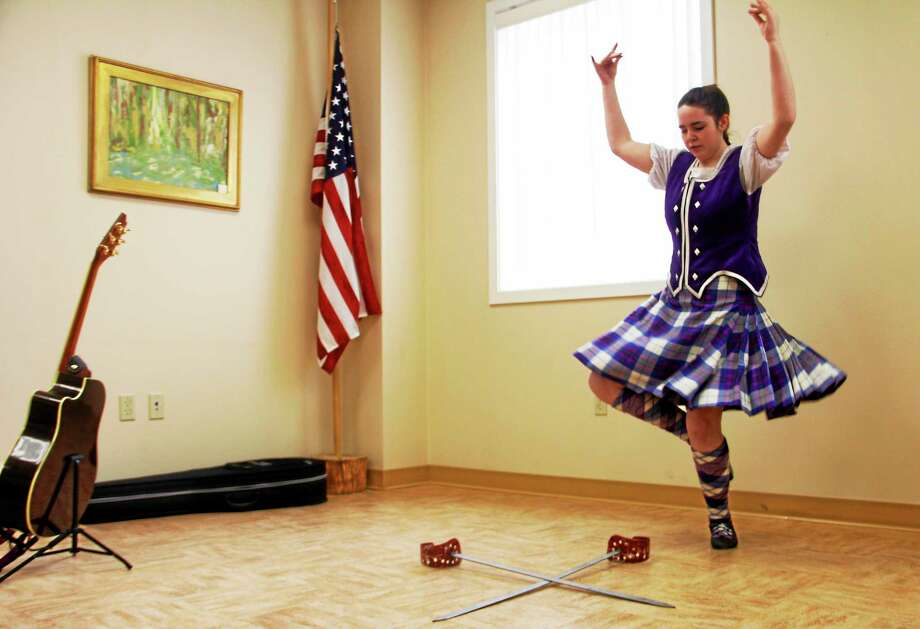 Kristyn McGhee performs a Scottish sword dance during a Scottish Highlands Music and Dance Festival on Saturday, March 8, 2014, in Barkhamsted. Photo: Esteban L. Hernandez Register Citizen