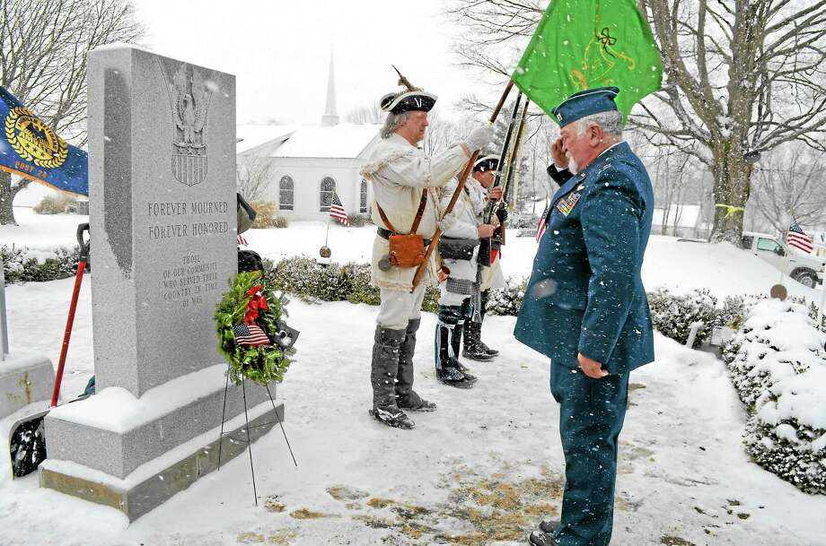 Reg Harrison saluted the Prisoner of War or Missing in Action holiday wreath during the Wreaths Across America ceremony at the All Wars Memorial in Bantam on Dec. 14. Photo: Kate Hartman—Register Citizen