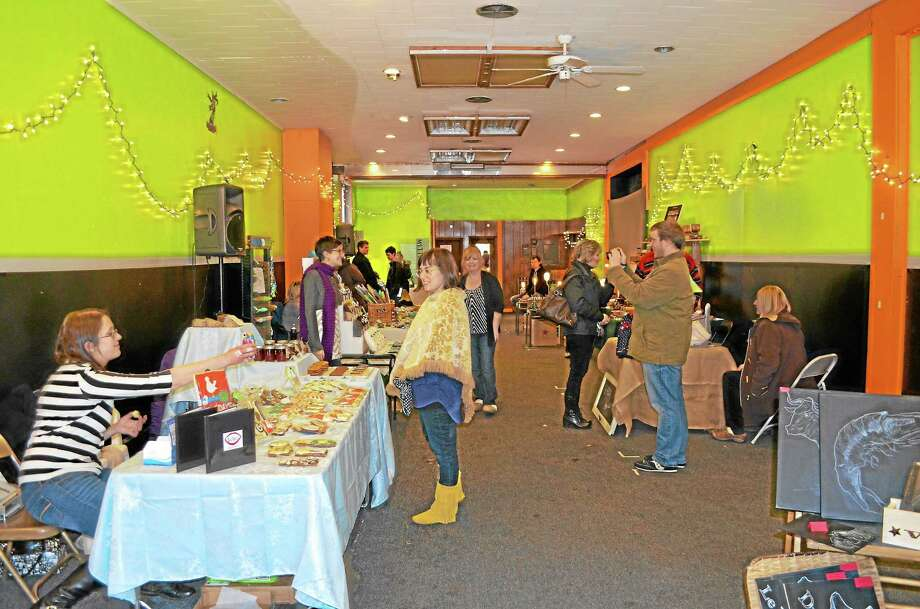 Sarah Galgano of Torrington put together the first Makers Market in a storefront at 15 Water St. on Dec. 14 to bring New England artisans together and encourage people to buy local. Photo: Kate Hartman—Register Citizen