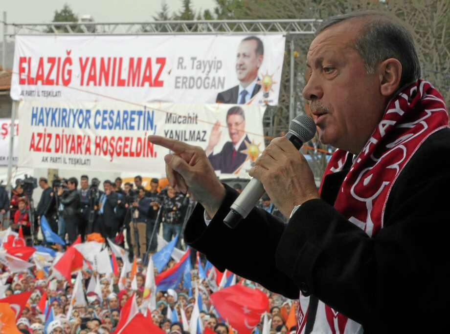 In this photo taken Thursday, March 6, 2014, Turkish Prime Minister Recep Tayyip Erdogan addresses a rally of his Justice and Development Party in Elazig, Turkey.  Erdogan has threatened drastic steps to censor the Internet, including shutting down Facebook and YouTube, where audio recordings of his alleged conversations suggesting corruption have been leaked in the past weeks, dealing him a major blow ahead of this month's local elections.(AP Photo/Burhan Ozbilici) . Photo: AP / AP