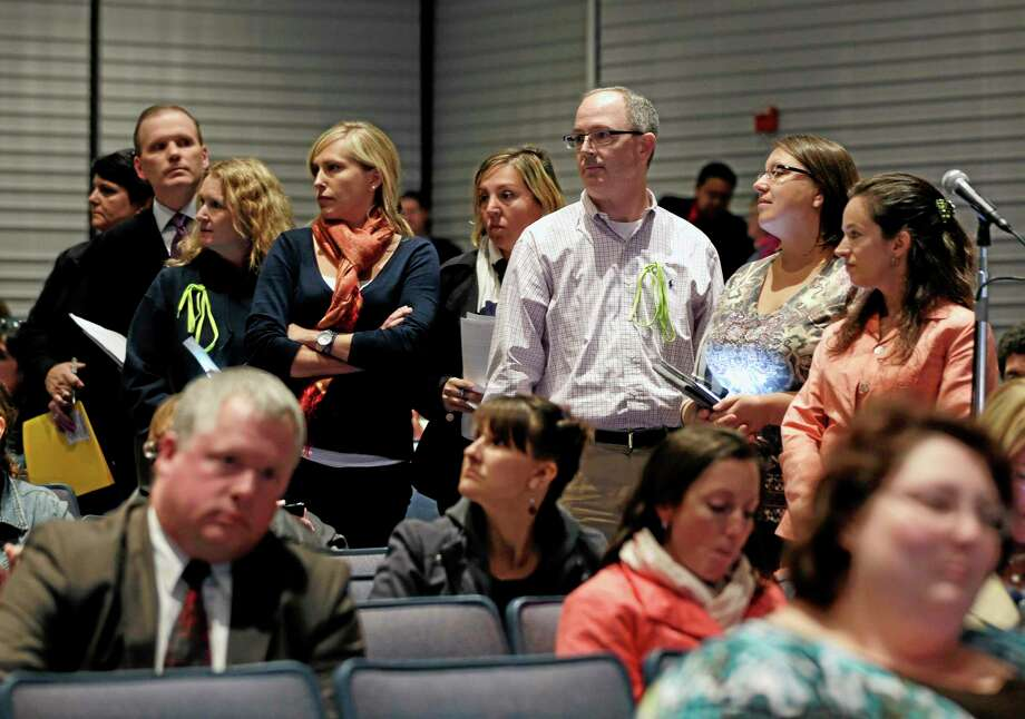 FILE--In this Oct. 24, 2013 file photo, people line up to speak at a Common Core learning reforms forum at the Stephen and Harriet Myers Middle School in Albany, N.Y. (AP Photo/Mike Groll, File) Photo: AP / AP