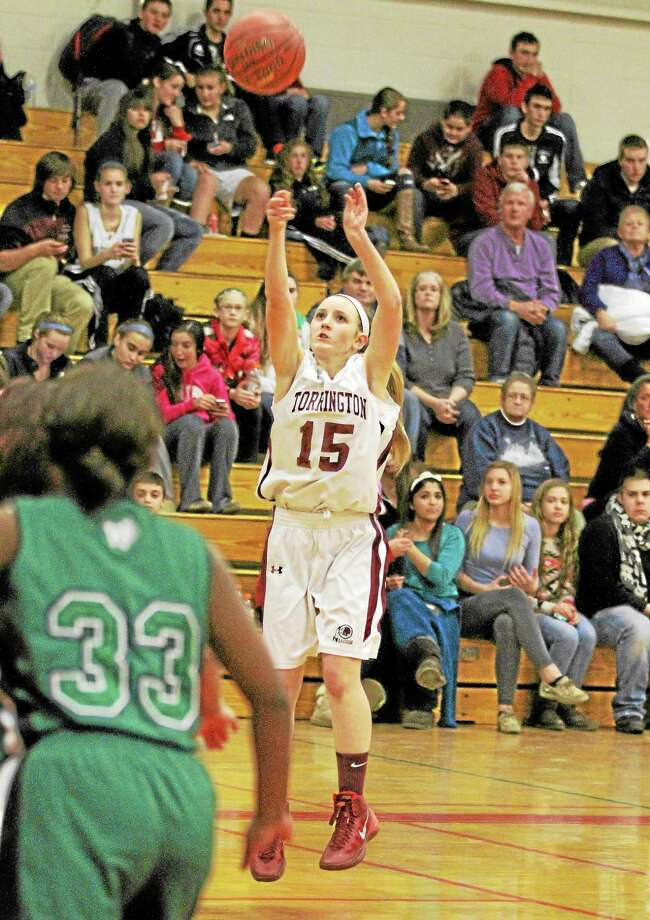 Torrington's Caroline Teti sinks a three-pointer in the Red Raiders 57-10 win over Wilby. Teti scored a game high 15-points. Photo: Marianne Killackey — Special To The Register Citizen  / 2013