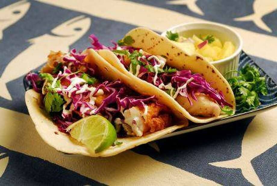 Baja-Style Fish Tacos with a lime-cumin creme drizzled on top and pineapple salsa, photographed in Walnut Creek, Calif., on Wednesday, July 31, 2013. (Mark DuFrene/Bay Area News Group) Photo: Bay Area News Group / Bay Area News Group