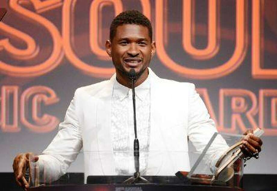 In this June 27, 2013 file photo, Usher accepts the golden note award at the 26th Annual ASCAP Rhythm & Soul Music Awards in Beverly Hills, Calif. Usher's ex-wife asked for and has received an emergency custody hearing after one of their sons nearly drowned in a pool at the singer's Atlanta home. Photo: AP / ASCAP net