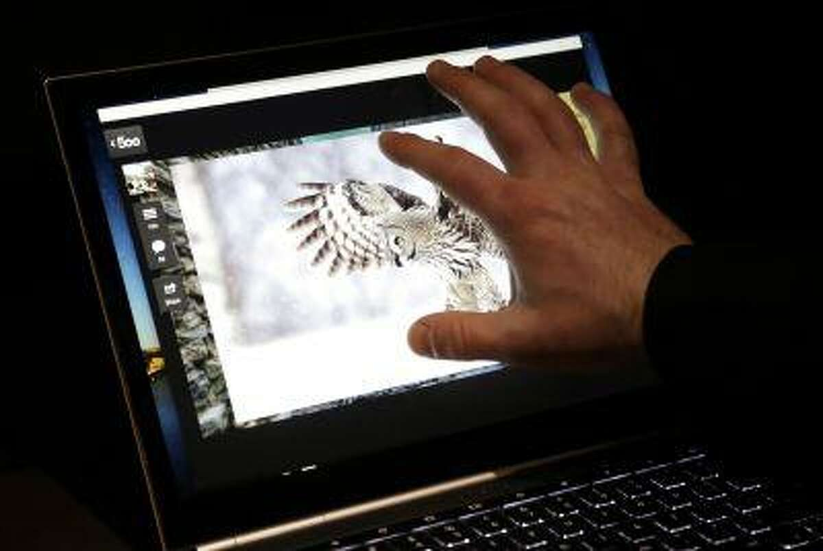 A man uses the touchscreen of the Google Chromebook Pixel laptop computer at an announcement in San Francisco, Thursday, Feb. 21, 2013. (AP Photo/Jeff Chiu)