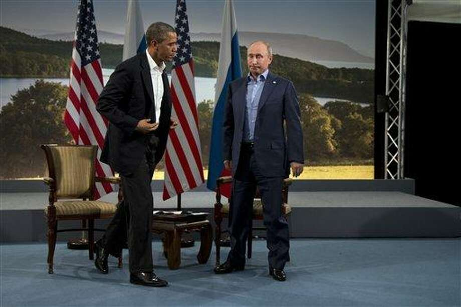 """In this June 17, 2013 file photo, President Barack Obama and Russian President Vladimir Putin get up to leave after their meeting in Enniskillen, Northern Ireland. President Barack Obama said he was """"disappointed"""" that Russia had granted temporary asylum to National Security Agency leaker Edward Snowden, defying administration demands that the former government contractor be sent back to the U.S. to face espionage charges.  (AP Photo/Evan Vucci, File) Photo: AP / AP"""