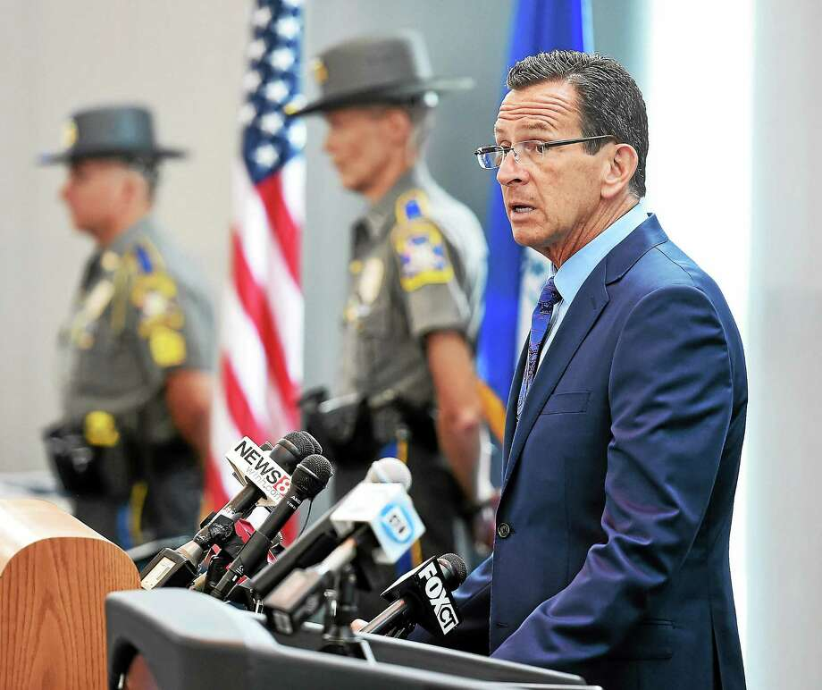 Connecticut Gov. Dannel P. Malloy speaks during an awards ceremony for troopers, local police, federal officers and civilians involved in the Sandy Hook shootings. The awards were held at Rentschler Field in East Hartford in July 2014. Photo: File Photo — New Haven Register