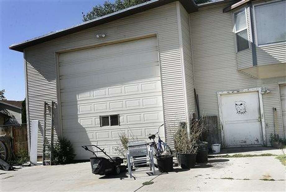 This Friday, Aug. 2, 2013 photo shows the Sandy, Utah home of man police say ran a speakeasy out of his garage for years.  Jared Williams, 33, has pleaded not guilty to the misdemeanor charge of running a business without a license, court records show. He was arrested June 13 after he sold drinks to an undercover officer earlier that month. (AP Photo/The Salt Lake Tribune, Scott Sommerdorf)  DESERET NEWS OUT; LOCAL TV OUT; MAGS OUT Photo: AP / The Salt Lake Tribune