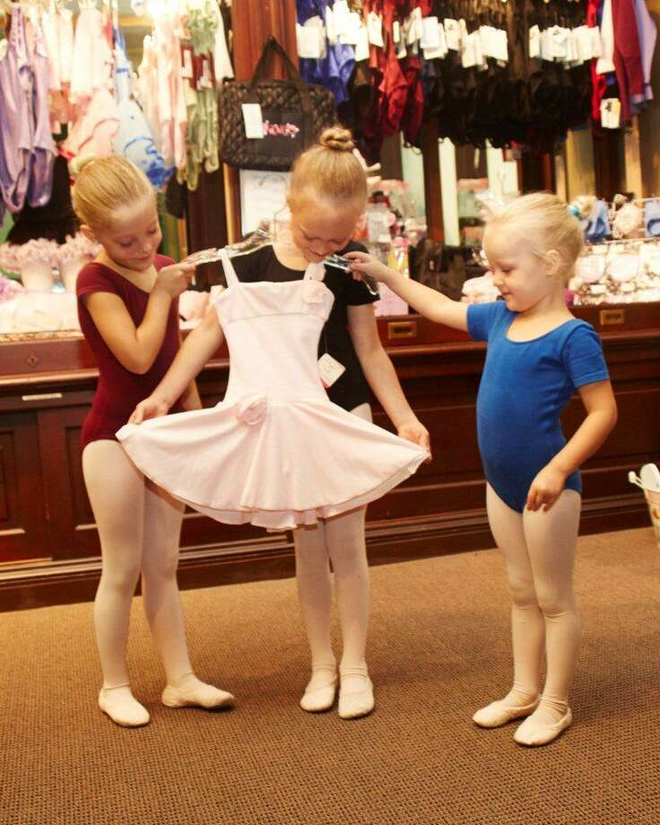Submitted photo - Nutmeg Children admire clothing in Nutmeg's Dress Shop in Torrington.
