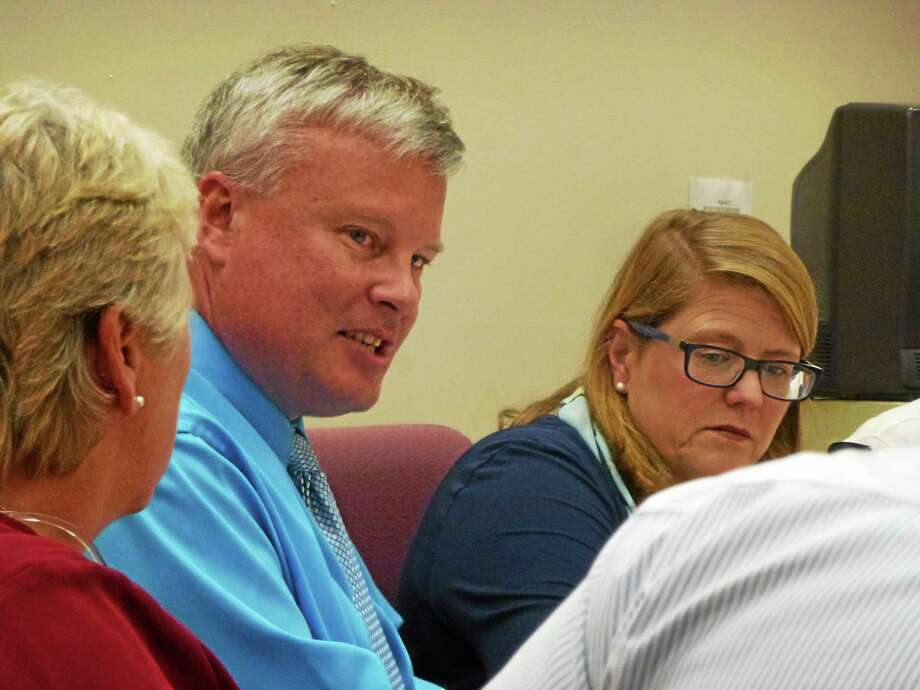 Mayor Marsha Sterling (right) stepped in for Dale Martin (center) while he was gone and spoke with convicted felon David Viens regarding the Lambert Kay sale, which then fell through. Photo: Ryan Flynn — The Register Citizen
