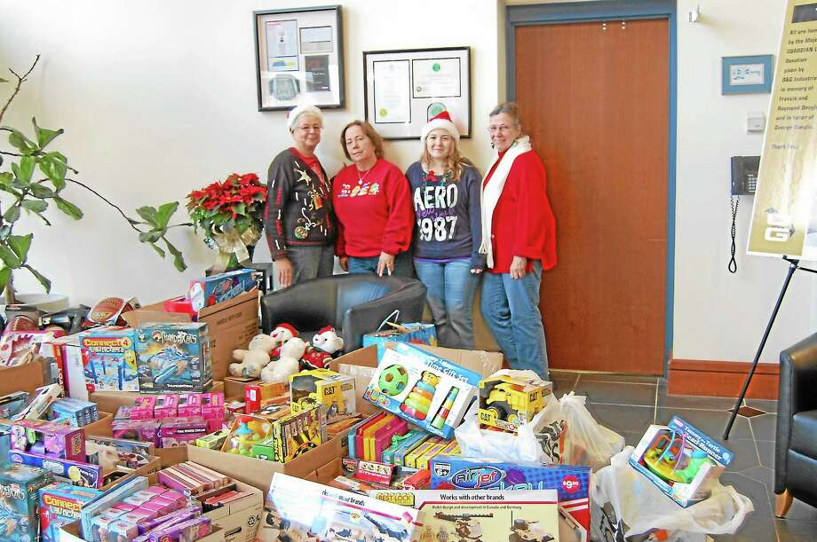 Shirley Durante, Sharon Okraska, Terry Creighton, and Anna Maye Weigold (from left to right) the organizers of the O&G Toy Drive for the Torrington FireFighters Christmas for Children fund. They raised $1500 in two months of collections which with smart shopping resulted in the mountain of toys. Photo: Jenny Golfin — Register Citizen