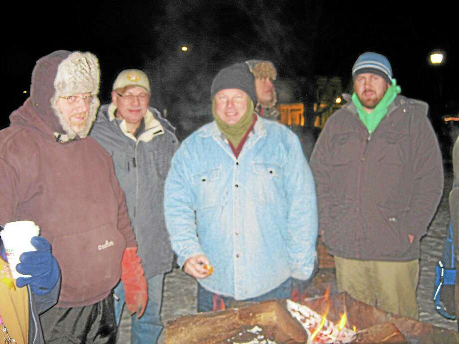 "Town Manager Dale Martin, center, and others gather in Winsted's East End Park on Dec. 13 for the YMCA's second-annual ""Freezin' for a reason"" event to raise awareness of the conditions faced by the homeless population. Photo: Gayla Cawley—For The Register Citizen"
