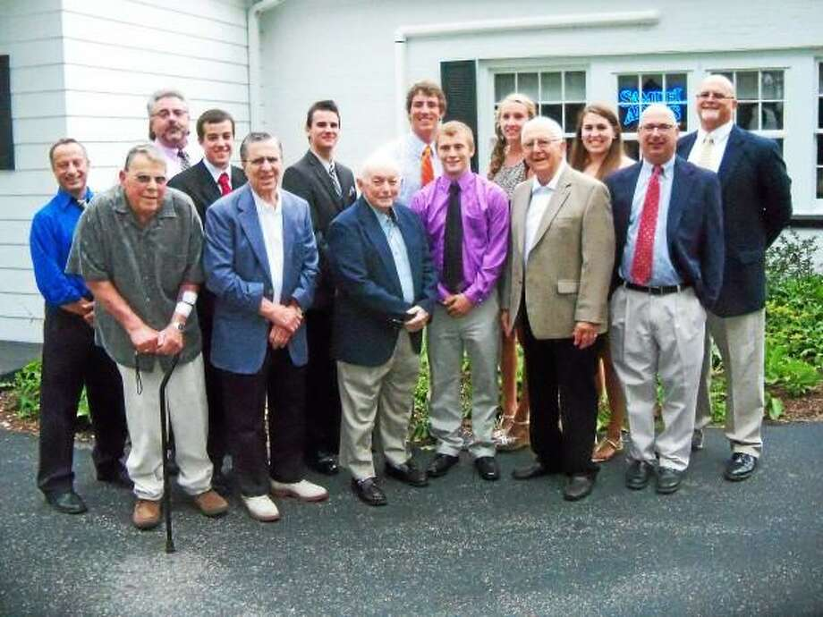 Peter Wallace-Register Citizen  The Varsity Alumni Club awarded its annual scholarships to Torrington student-athletes Wednesday evening at PSam's Restaurant. Front row, left to right, is Dominic Toce, Andy Pace, Frank Russo, Matt Scoville, Lou Zanderigo and Paul O'Heron. Back row, left to right: Mario Longobucco, Fred Bonvicini, Ben McKenna, Austin Kelson, Kevin Finn, Nicole Kozlak, Megan Calabrese and Paul Denza.