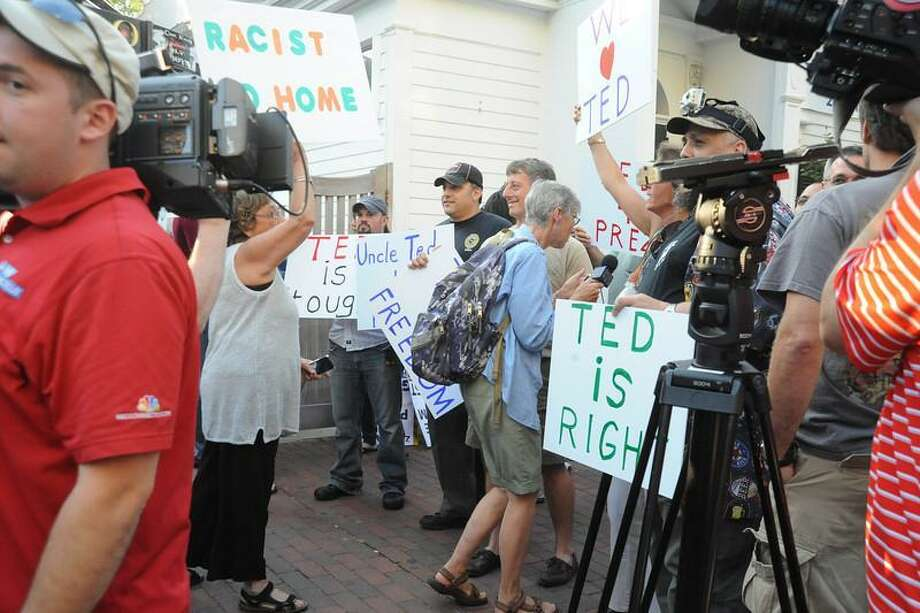 Protesters outside of Toads in New Haven as they demonstrate against Ted Nugent  Vern Williams/New Haven Register