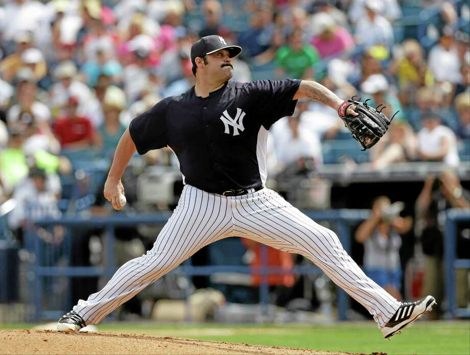 Former New York Yankees relief pitcher Joba Chamberlain and the Detroit Tigers have agreed to terms on a one-year contract, according to sources. Photo: Kathy Willens — The Associated Press  / AP