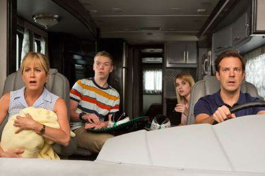 """This film image released by Warner Bros. Entertainment shows, from left, Jennifer Aniston, Will Poulter, Emma Roberts, and Jason Sudeikis in a scene from """"We're the Millers."""" (AP Photo/Warner Bros. Entertainment, Michael Tackett)"""