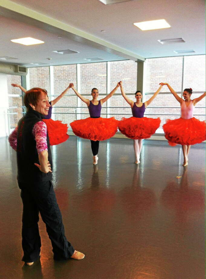 Submitted photo - Nutmeg Ballet Conservatory MOMIX Associate Director, Cynthia Quinn, rehearsing ìMarigoldsî with the students of The Nutmeg Ballet Conservatory. Photo: Journal Register Co.
