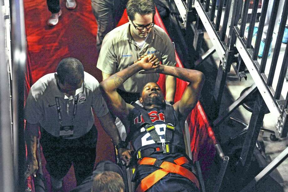 Indiana Pacers' Paul George is carted off the court after breaking his leg Friday night. Photo: Glenn Pinkerton — The Associated Press  / Las Vegas News Bureau