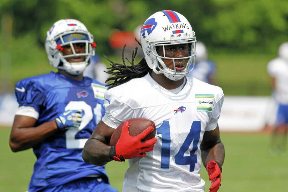 Bills wide receiver Sammy Watkins (14) runs after a reception against corner back Leodis McKelvin (21) during training camp in Pittsford, N.Y. on Monday. Photo: Bill Wippert — The Associated Press  / FR170745 AP