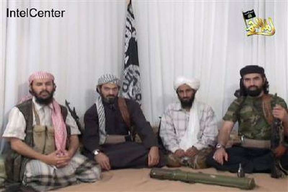 FILE - This file image provided by IntelCenter on Wednesday Dec. 30, 2009, and taken from a video released Jan. 23, 2009, by al-Malahim Media Foundation, the media arm of al-Qaida in the Arabian Peninsula, allegedly shows men whom IntelCenter identifies as the senior leaders of al-Qaida in the Arabian Peninsula, with from left: military leader Qassim al-Raimi, deputy leader Saeed al-Shihri, leader Nasser al-Wahishi, and Abu al-Hareth Muhammad al-Oufi. Once Osama bin Laden's aide-de-camp, Wahishi is the top leader of AQAP. In Feb. 2006, Wahishi was among 23 al-Qaida militants who broke out of a detention facility in Sanaa, Yemen's capital. Al-Raimi became the group's military commander and the brains behind a series of foiled attacks in US. In writings and videos, he has vowed to topple the now ousted Saleh's regime and to strike America. (AP Photo/IntelCenter, File) NO CROPPING - MANDATORY CREDIT - NO SALES Photo: AP / IntelCenter
